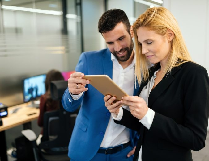 business people-discussing-while-using-digital